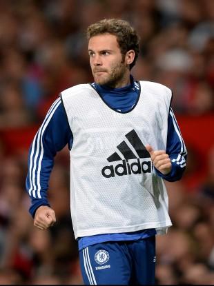 Mata warming up at Old Trafford on Monday.
