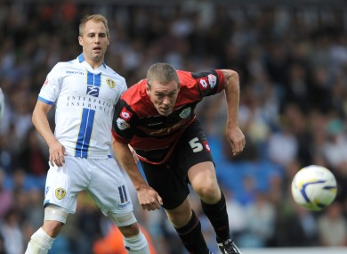 Leeds United's Luke Varney and Queens Park Rangers' Richard Dunne during today's game.