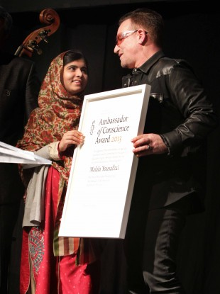 Malala on stage at the Mansion House this evening with Bono