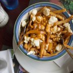 Originally from Quebec, poutine is a delicious calorie-fest that will warm you from the inside. It's chips topped with brown gravy and cheese curds. Quora user Josianne C. nominated this tasty dish.<span class=