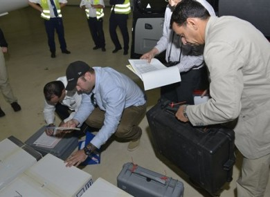 At the Organization for the Prohibition of Chemical Weapons, samples brought back by the U.N. chemical weapons inspection team are checked in upon their arrival at The Hague, Netherlands