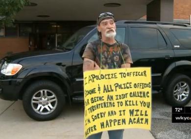 Richard Dameron holding his sign.