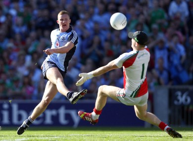 Ciaran Kilkenny of Dublin has a shot saved by Mayo goalkeeper Robert Hennelly.
