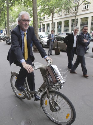 Brian Cookson poses for photographs after a press conference in Paris.