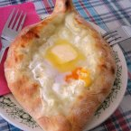 Khachapuri, suggested by Quora user Otar C., is a savoury, chewy bread that's filled with bubbling cheese or egg from the small Eastern European country of Georgia.<span class=