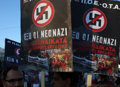 Protesters hold placards that read ''Neo-Nazis out from the unions and workplaces