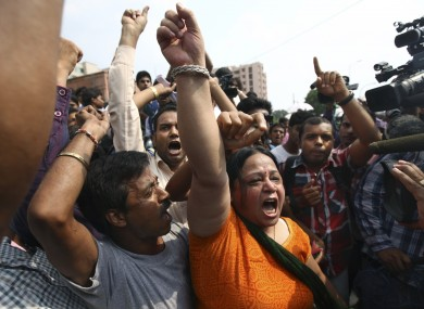 Protesters shout slogans demanding the death penalty for the four men earlier this week