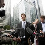 Edourd D'Archimbaud, 24, from Paris, who started his first day's work at Lehman Brothers, speaks to the press after learning that he no longer has a job there<span class=