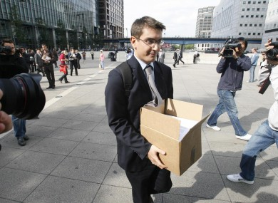 A worker holding a box, leaves the Lehman Brothers headquarters at Canary Wharf in London on Monday 15 September 2008
