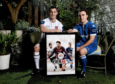 Dundalk's Patrick Hoban and Shane Tracy from Limerick FC pose on the cover of FIFA 14.