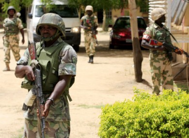 Nigerian soldiers stand guard at the offices of the state-run TV station. (Dated 6 June)