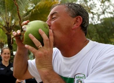 Noel King enjoys a coconut at Maracas Bay, Trinidad in 2010.