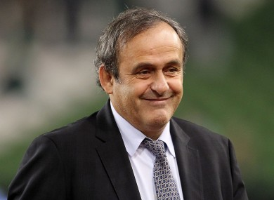 Michel Platini has admitted politics played a role in Qatar being given the World Cup.