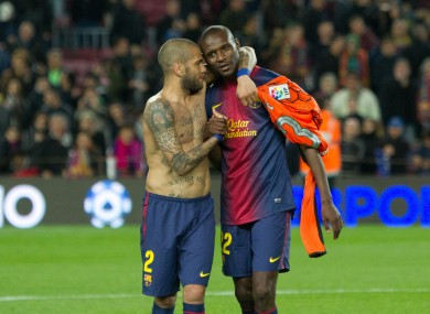 Alves, left, with Abidal before the Frenchman left Barcelona.
