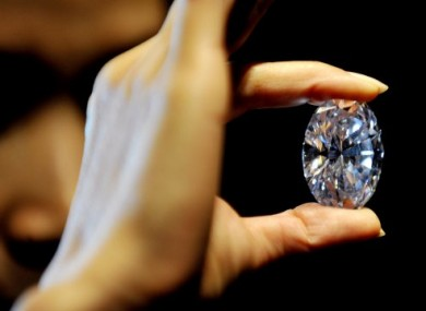 A Sotheby's employee displays the 118-carat diamond.