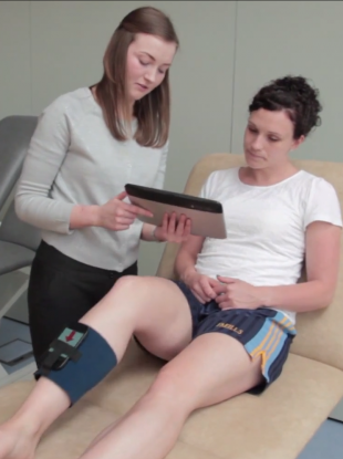 Physio Oonagh Giggins, left, demonstrates how a smartphone strapped to a limb can be used as a sensor to give feedback on how an exercise is being performed.