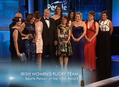 Lynne Cantwell holds the Six Nations trophy as the Irish team are presented with their award.