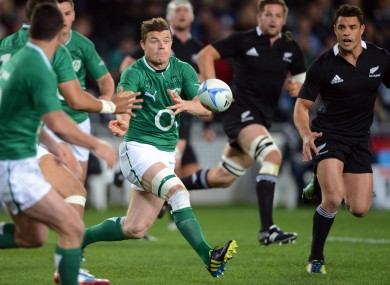 Brian O'Driscoll spins a pass under the watchful gaze of Richie McCaw and Dan C