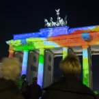 Laser projections illuminate Berlin's famous landmark Brandenburg Gate during a light rehearsal for the Festival of Lights in Berlin, Germany. <span class=