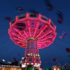 A merry-go-round rotates at the 180th Bavarian