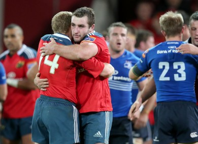 Replacement Munster prop James Cronin celebrates with try-scorer Keith Earls.