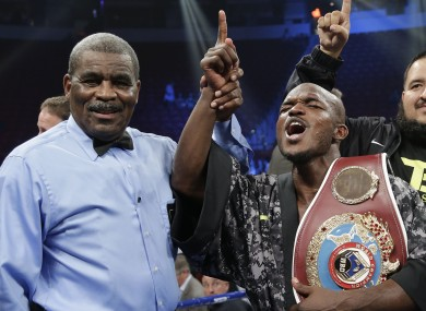 Timothy Bradley shouts to fans as he poses for photos with the title belt and referee Robert Byrd.