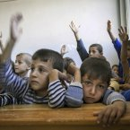 Syrian children attend class at the public school in Madaya village on Thursday.<span class=