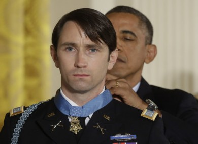 President Barack Obama awards the Medal of Honor to retired Army Captain William D. Swenson of Seattle, Washington yesterday.