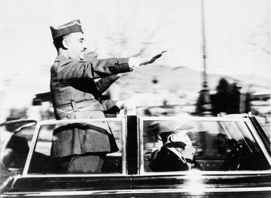 General Francisco Franco, leader of the Nationalist forces, salutes from his specially built armored car as he makes a triumphant entry into Barcelona in March 1939.