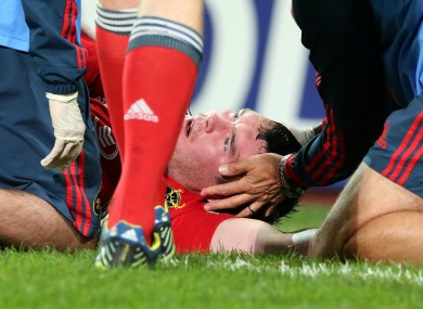 Peter O'Mahony is assessed by Munster medics after taking a heavy blow.
