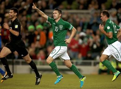 Keane celebrates scoring his 61st senior international goal.