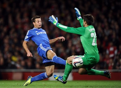 Chelsea's Cesar Azpilicueta (left) scores his teams opening goal ahead of Arsenal goalkeeper Lukasz Fabianski.
