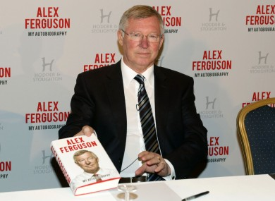Sir Alex Ferguson with his Autobiography during the photocall at the Institute of Directors.
