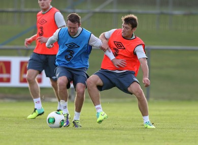 Scottish-born Aiden McGeady is tackled by Dubliner Wes Hoolahan at training this week.