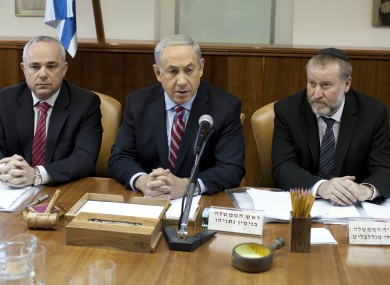 Israeli Prime Minister Benjamin Netanyahu, center, attends the weekly cabinet meeting at his office in Jerusalem, Israel