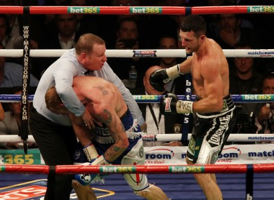 Referee Howard Foster stops Groves in the ninth round.