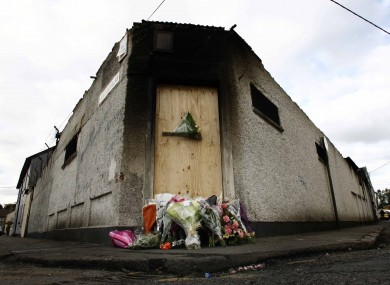 Flowers laid at the site of the factory fire which claimed the lives of the two firefighters.