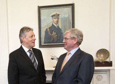 Peter Robinson with Eamon Gilmore in 2011.