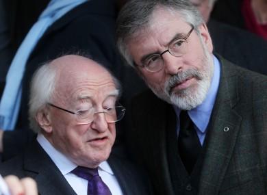 President Michael D Higgins with Sinn Féin's Gerry Adams at a funeral mass for Fr Alex Reid in Dublin this week