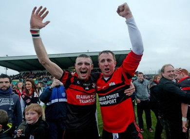 Mount Leinster's Gary Kelly and goalkeeper Frank Foley celebrate after yesterday's game.
