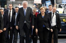 After two months, Merkel forms coalition government in Germany