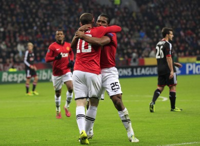 Manchester United's Antonio Valencia celebrates with Wayne Rooney.