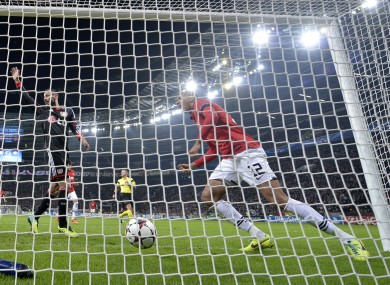 Manchester United's Chris Smalling scores during the Champions League group A game against Bayer Leverkusen last night.