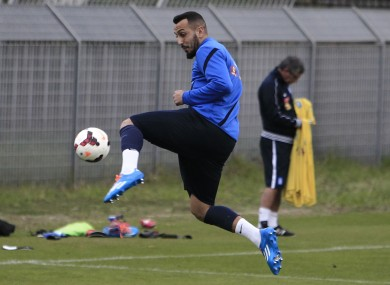 Greece's Kostas Mitroglou controls the ball during a training session in Athens yesterday.