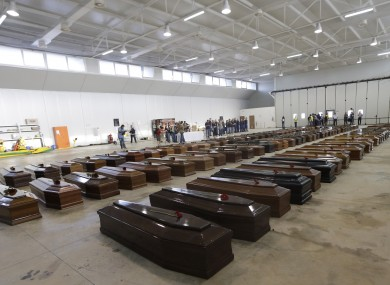 Coffins of some of the dead migrants inside a hangar at Lampedusa's airport in Italy on 5 October.