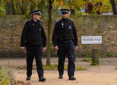 Police officers patrol near flats in Brixton, south London, as police are conducting house-to-house inquires in the area where three women were allegedly held as slaves for at least 30 years were rescued.