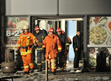 Rescuers work at the Maxima grocery store after its roof collapsed in Riga.