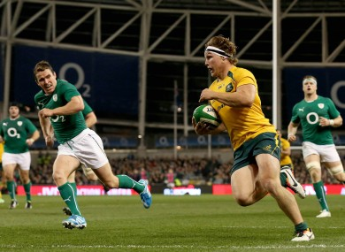 Australia's Michael Hooper runs in their second try of the game.