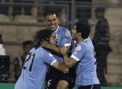 Uruguay trio Maxi Pereira, Edison Cavani and Luis Suarez celebrate one of the five goals.