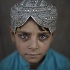 Afghan refugee Hasanat Mohammed, 5, poses for a picture while standing outside his home in a poor neighbourhood on the outskirts of Islamabad, Pakistan. Pakistan hosts over 1.6 million registered Afghans, the largest and most protracted refugee population in the world, according to the U.N. refugee agency, thousands of them still live without electricity, running water and other basic services. <span class=